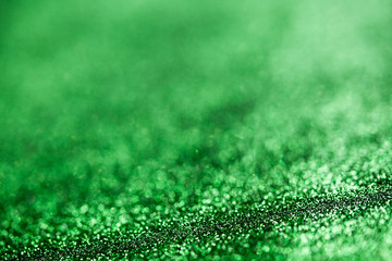 Green glitter surface with green light bokeh - It can be used for background for special occasions promotion campaign or product display