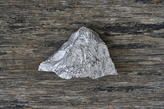 Silver ore on wood plate