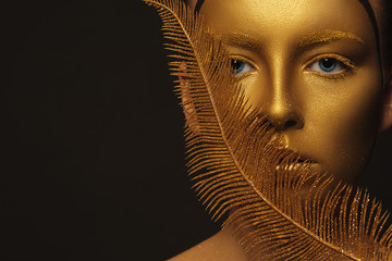 amazing woman with a gold skin