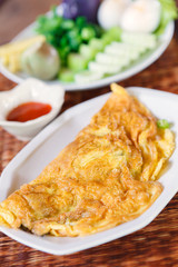 Thai style omelet on white plate. Thai Food