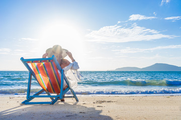 Woman at beautiful beach on a sunbed