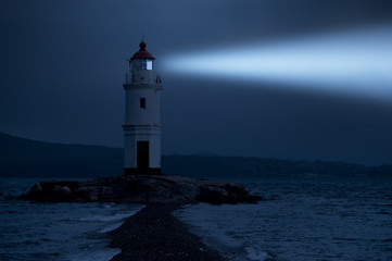 Lighthouse in Vladivostok shines at night in the sea