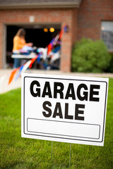 Garage Sale Sign in Home Front Yard