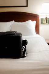 Suitcase on Hotel Room Bed