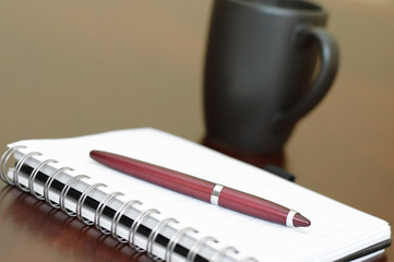Spiral Notepad and Coffee Cup on Desk Picture