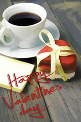 Romantic breakfast on Valentine's Day. Cup of coffee and heart shape cookies, white rose decoration, sticker for text. Toned image