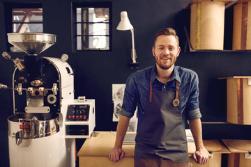 Entrepreneur in his modern coffee roastrery and distribution spa Wall mural