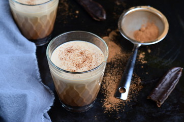 Carob Drink, Cocoa or Coffee Milk Drink on dark background