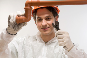 Man fixing tube