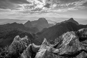 Layer of mountains and mist at sunset time, Landscape at Doi Luang Chiang Dao, High mountain in Chiang Mai Province, Thailand. Black & White
