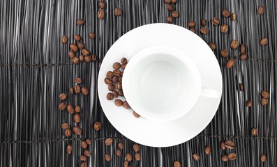 Empty coffee cup with coffee beans