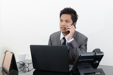Business man talking telephone in office
