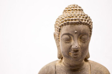 Buddha statue close up on a white background
