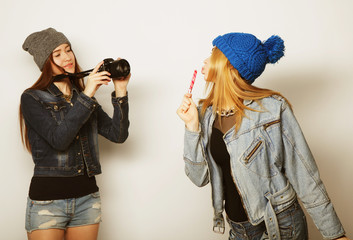 a girl takes picture of her friend