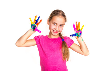 Happy little girl with her hands in paint