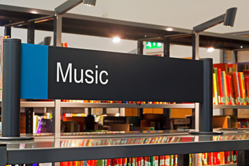 Canvas Prints Music store Music section sign inside a modern public library