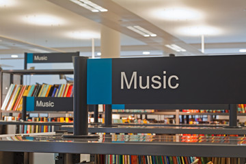 Printed roller blinds Music store Music section sign inside a modern public library