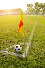 Corner flag with ball on a soccer field