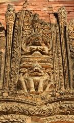 Ancient figure oo top of gate in Bagan temple, Myanmar