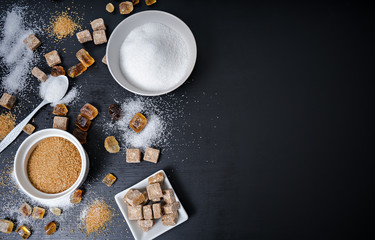 different types of sugar on black table Wall mural