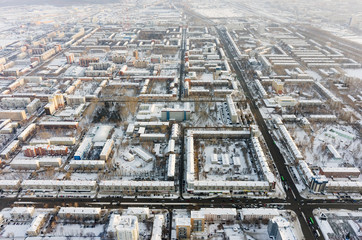 Tyumen, Russia - January 23, 2016: Aerial view on residential area with TV towers on background