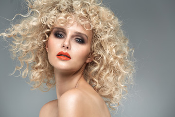 Beautiful blond lady with gorgeous curly coiffure