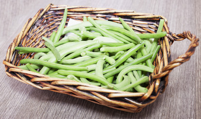 Green beans in wooden tray