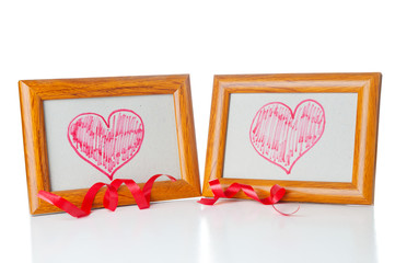 Drawn hearts  in the photo frames on white background