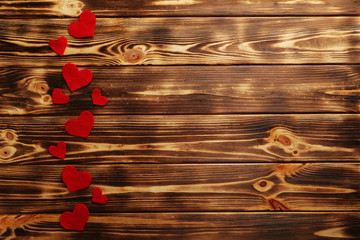 Red hearts on a brown wooden table