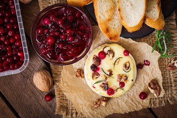 Baked cheese Camembert with cranberries and nuts. Top view