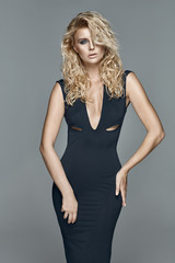 Beautiful alluring blond woman in a black dress
