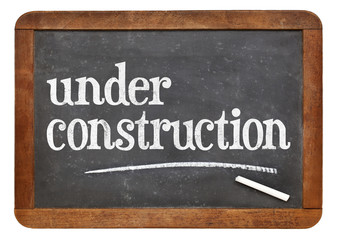 under construction blackboard sign