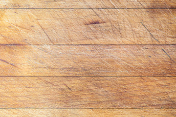 Rough wooden used cutting board background with horizontal lines and cutting traces