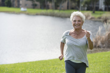 Senior Caucasian woman jogging in park