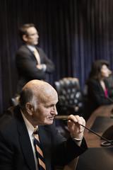 Caucasian politician debating in chamber