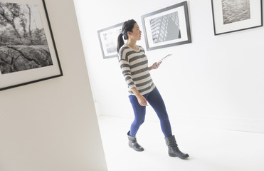 Korean woman admiring art in gallery