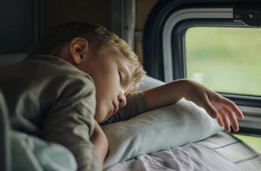 Sleeping boy in front of window