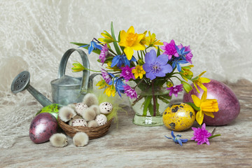 Easter, spring flowers and painted eggs