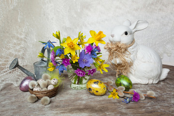 Easter, spring flowers, colored eggs and bunny