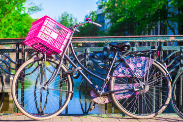 Colorful bikes on the bridge in Amsterdam, Netherlands
