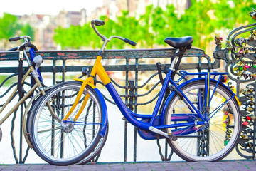 Colorful bikes on streets in Amsterdam, Netherlands