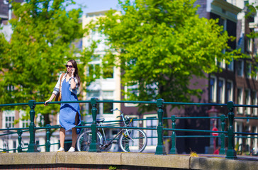 Young caucasian girl enjoy european vacation in Amsterdam, Holland