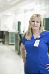 Nurse smiling in hospital corridor