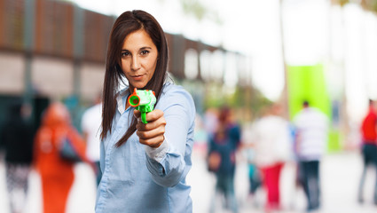 cool young woman with pop gun