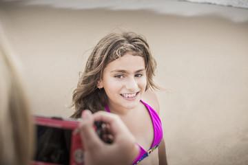 Girl posing for photograph on beach