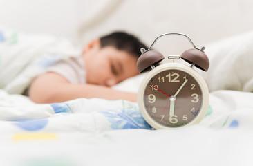 alarm clock and sleep child