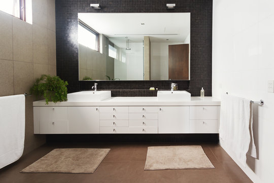 Double basin vanity and mirror in contemporary new bathroom
