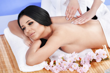 Beautiful young woman getting spa treatment at salon