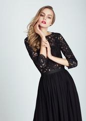 Beautiful young woman in dress.