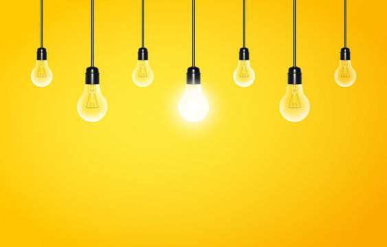 Hanging light bulbs with glowing one on a yellow background, copy space. Vector illustration for your design.